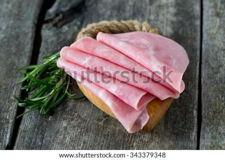 pork ham on wooden surface - stock photo