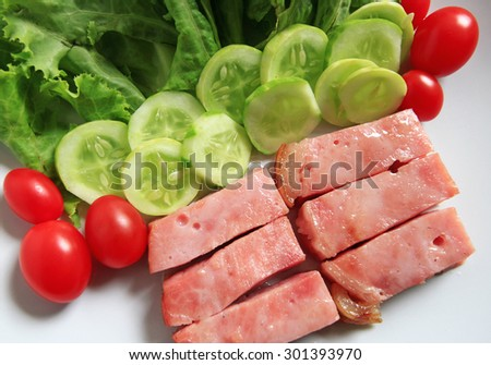 Pork ham with fresh salad and vegetables - stock photo