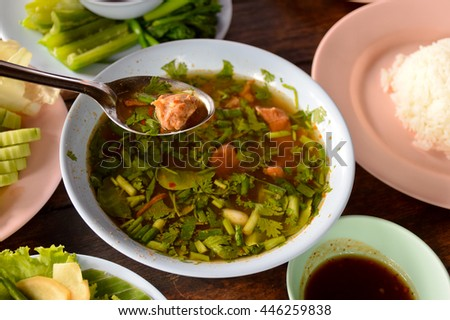 pork hot and sour soup, wood table,   food of northern Thailand - stock photo