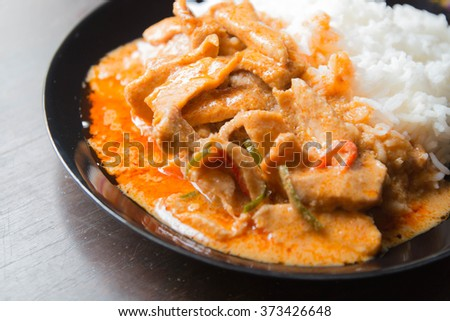 Pork in ground peanut-coconut cream curry serve with rice.