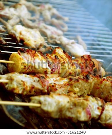pork kebab with onion on the BBQ - stock photo
