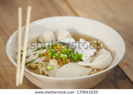 Pork meatballs and steam fish in noodle soup