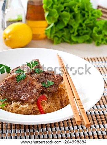 Pork medallions in oyster sauce with noodles - stock photo