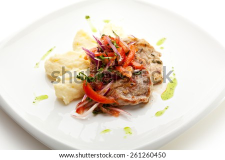 Pork Medallions with Mushed Potato and Salsa Sauce - stock photo