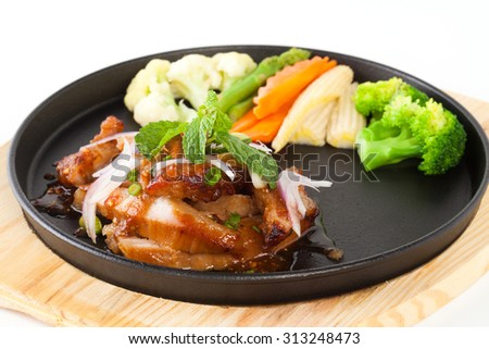 pork neck grill isolated on black plate on white background (Thai style food)