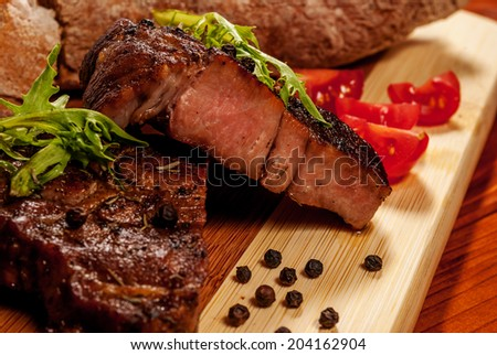 Pork neck steak with vegetables and pepper - stock photo