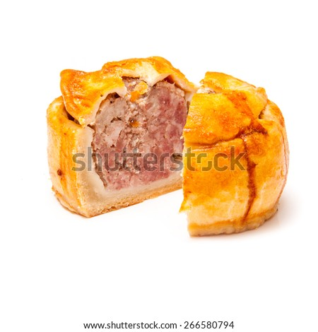 Pork pie isolated on a white studio background. - stock photo