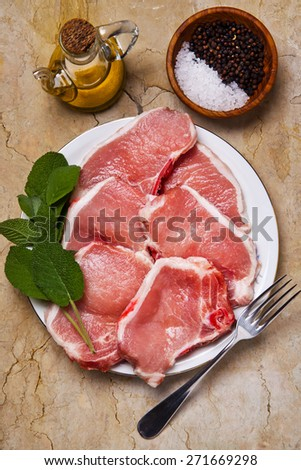 pork raw loin with olive oil & sage. Ingredients - stock photo