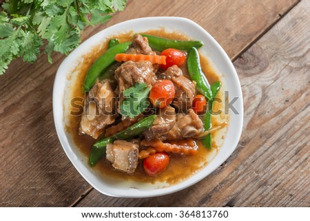 Pork ribs braised with soy sauce and vegetable. Top view. - stock photo