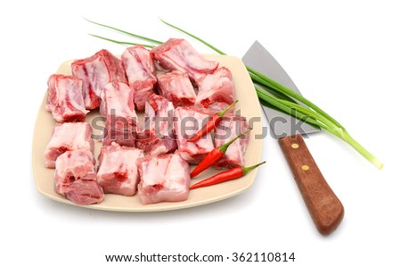 pork ribs chopped with vegetables on white background  - stock photo