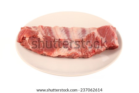 pork ribs on white dish isolated on white background