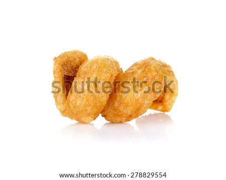 Pork rind favorite food in Thailand (Lanna) isolated on white.