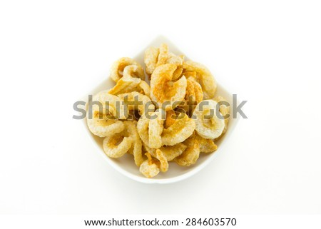 pork rinds also known as chicharon or chicharrones, deep fried pork skin - stock photo