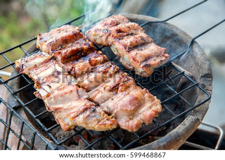 Pork rips grilled on the charcoal stove