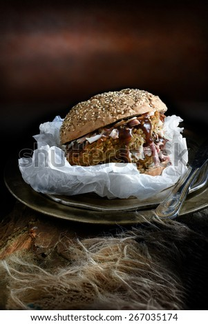 Pork, sage & onion stuffing and rich gravy pork roll. The perfect image for your restaurant or bistro menu designs. Shot in creative lighting in a rustic setting against a dark background. Copy space. - stock photo