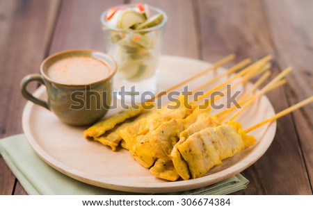Pork satay,Grilled pork served with peanut sauce or sweet and sour sauce - stock photo