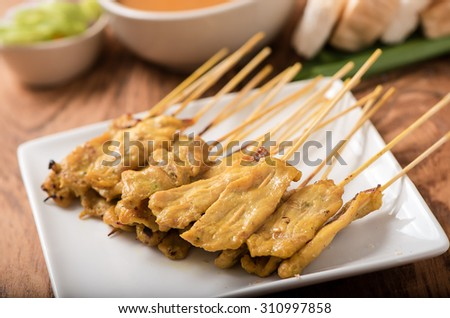 Pork satay,Grilled pork set on wood table , thai style - stock photo