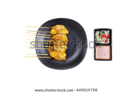 Pork satay on black plate with bean sauce isolated on white background - stock photo