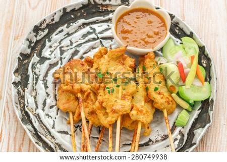 Pork Satay, Traditional Thai steak roasted pork on wood table - stock photo