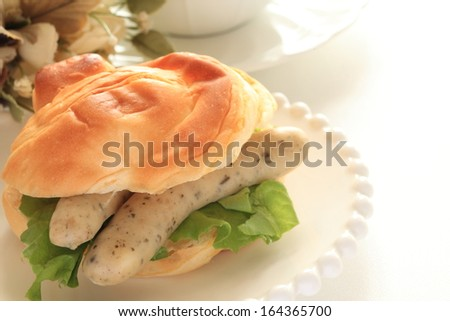 pork sausage and lettuce sandwich