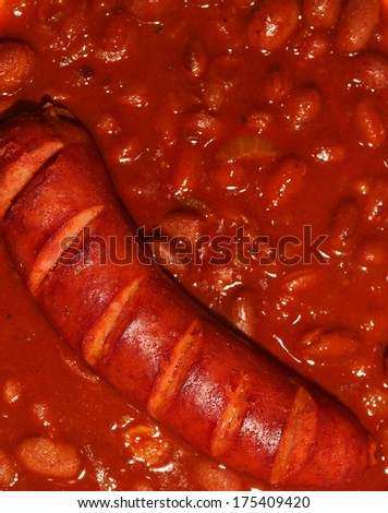 Pork sausages and baked beans/Beans With Sausage - stock photo