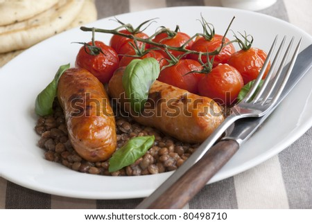 Pork sausages with green lentils and roasted cherry tomatoes