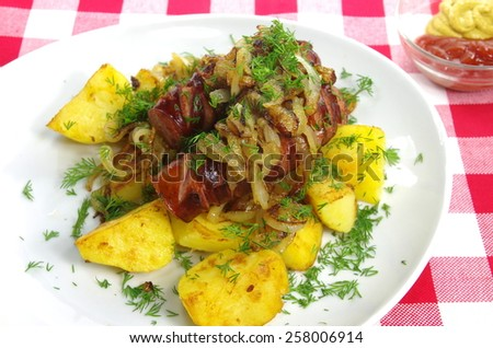 pork sausages with potato onion and dill - stock photo