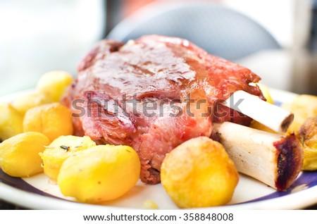 pork shank roasted with potatoes ( stinco di maiale con patate arrosto ...