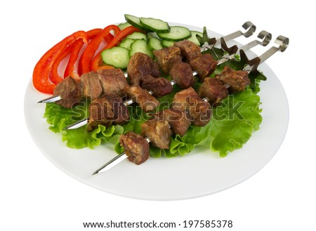 pork shish kebab with herbs, peppers and cucumbers isolated on white background - stock photo