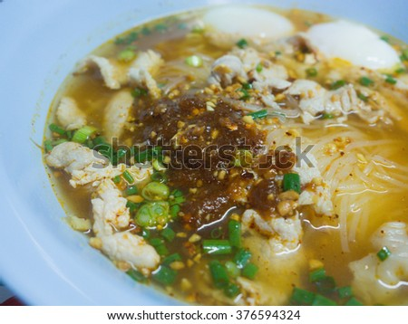 pork spicy noodle,thai style pork noodle  with tomyam soup (focus spicy sauce)