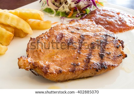 Pork steak in white plate