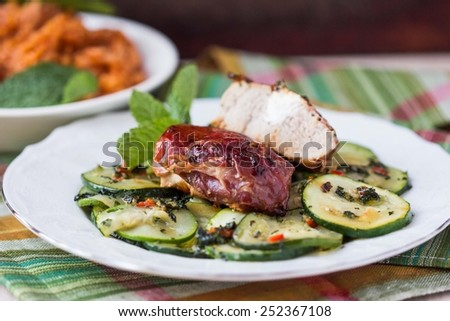 Pork steak, meat stuffed with feta cheese with bacon pancetta and zucchini salad - stock photo