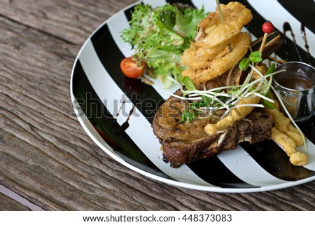 pork steak serve on back and white dish plate old wood table