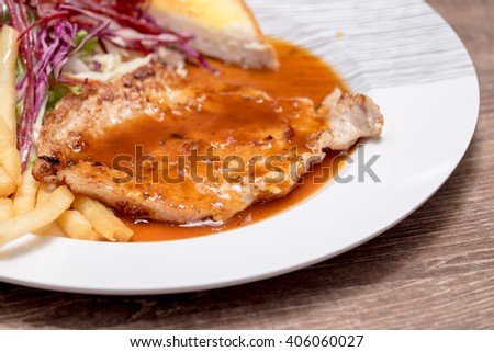 pork steak with barbecue sauce,French Fries and garlic bread