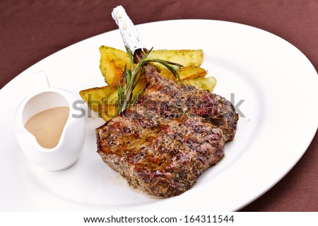 Pork steak with potato - stock photo