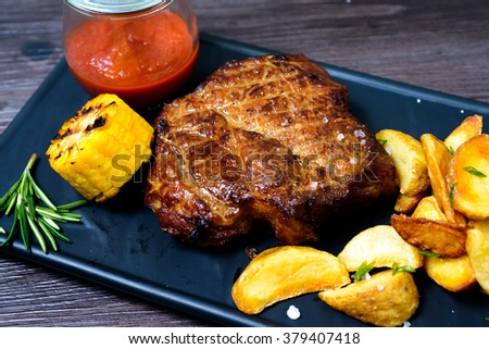 Pork steak with potatoes and vegetables - stock photo