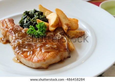 Pork Steak with Shiitake sauce and fried potatoes