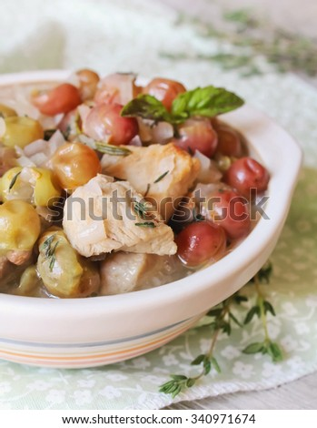 Pork stew with red grape, thyme and basil in a bowl, selective focus - stock photo