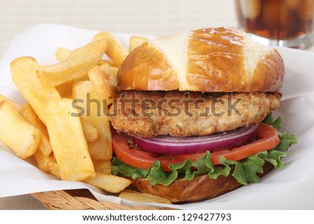 Pork tenderloin sandwich with french fries in a basket