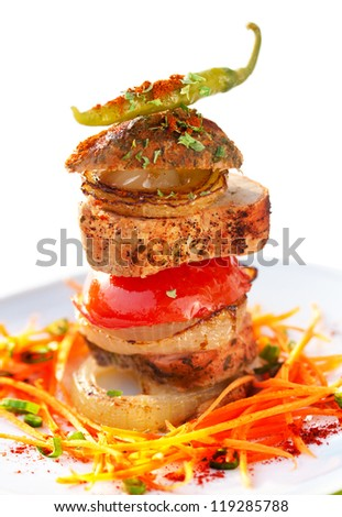 Pork tenderloin with fried vegetables and carrot salad - stock photo