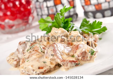 Pork with mushrooms and cream sauce