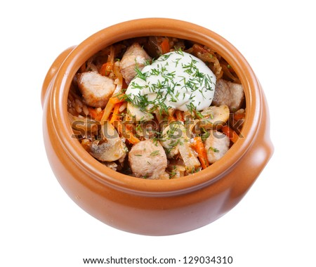 pork with mushrooms, carrots and onions in a ceramic crock pot, isolated - stock photo