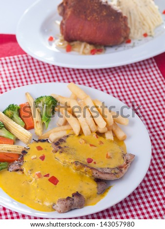 pork with mustard source  and German pork leg - stock photo