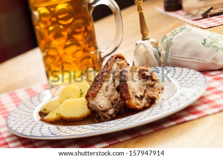 pork with potatoes and beer - stock photo
