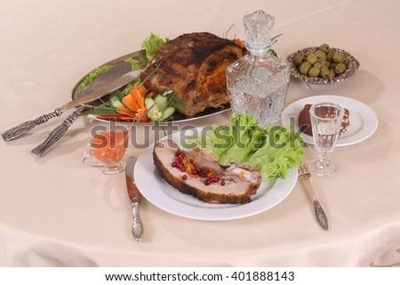 pork with vegetables served with cranberry and vodka in the jug