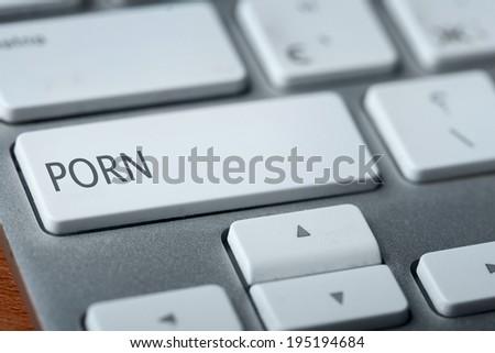 porn on keyboard - stock photo
