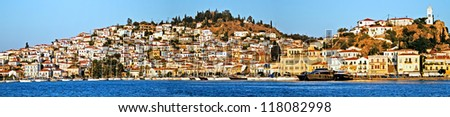 Poros Island, Saronic gulf, Greece, harbor, view from the sea. Poros is a volcanic Island formed through the union of 2 smaller islands, Kalourla and Sphaeria. The island is part of Saronic islands