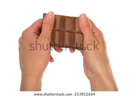 Porous milk chocolate in the female hands, isolated on white - stock photo