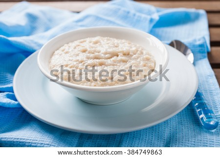 porridge in a bowl on a table, selective focus