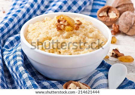 Porridge in a bowl with nuts and raisins